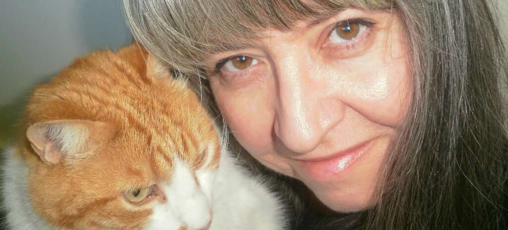 Liz and Hector cat selfie featured